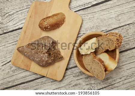 different kind of bread on wooden background