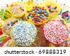 Different kind of colorful cup cakes on a decorated background - stock photo