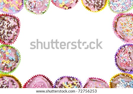 Different kind of decorated cup cakes used as frame - stock photo