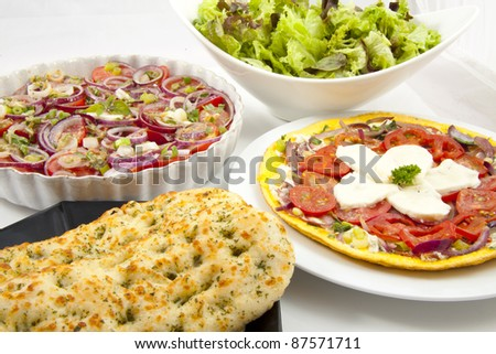 Different kind of fresh salad with garlic bread for background use