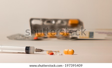 Different kind of medications: injection or pills...But this can also be addiction drug - stock photo