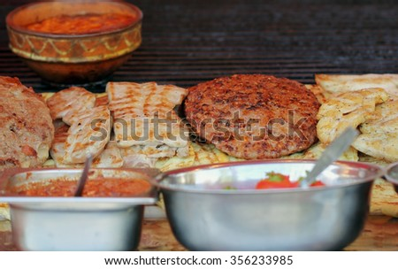 Different kind on grilled meat with smoke and steam from the grill