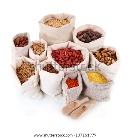 Different kinds of beans in sacks isolated on white - stock photo