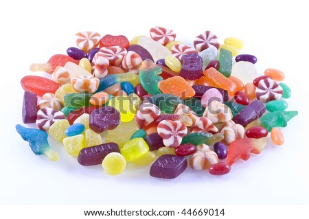 Different kinds of candy on a white background.