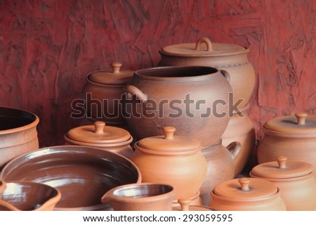 Different kinds of ceramics pots for sale taken closeup. - stock photo