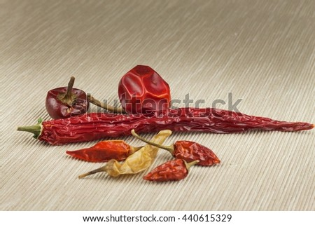Different kinds of dried chili peppers. Dried red chili peppers. Hot spices to food. - stock photo
