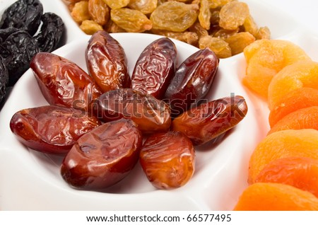 Different kinds of dried fruits on white background - stock photo
