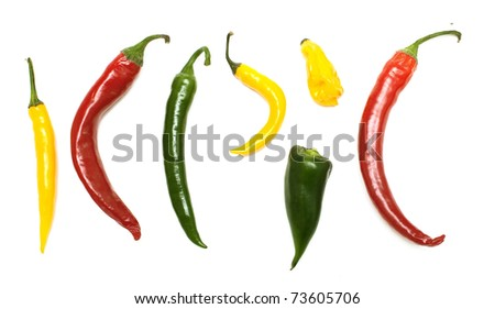 different kinds of hot pepper on white background, top view - stock photo