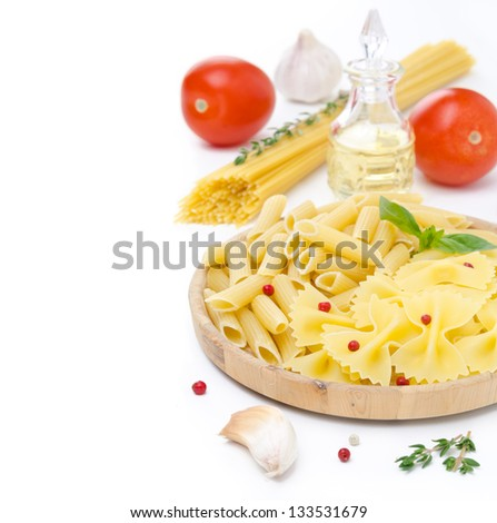 different kinds of Italian pasta, fresh tomatoes, olive oil and spices isolated on a white background - stock photo