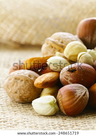 different kinds of nuts (almonds, walnuts, hazelnuts, pistachios) - stock photo