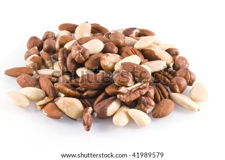 Different kinds of nuts; isolated on white. - stock photo