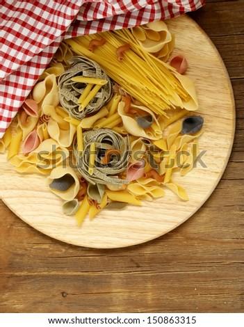 different kinds of pasta (spaghetti, fusilli, penne, linguine) - stock photo