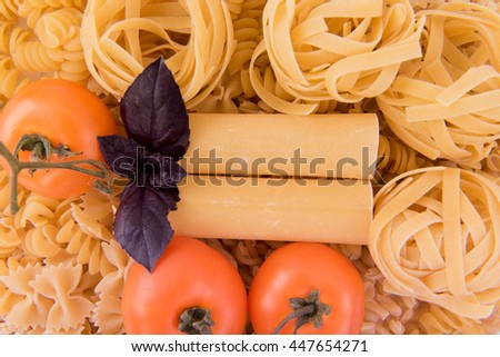 different kinds of pasta with tomato and Basil