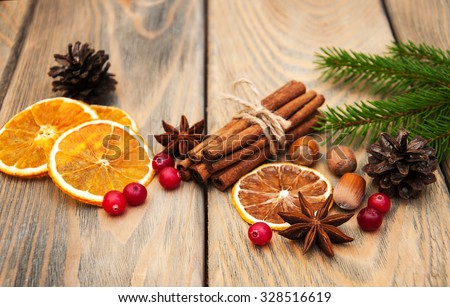 different kinds of spices  and dried oranges with christmas tree - stock photo