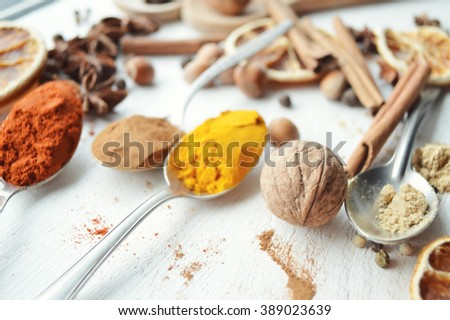 Different kinds of spices on wooden background