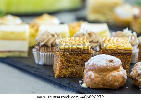 Different Kinds of Tasty Cakes, Buffet Brunch Food Eating Festive Cafe Dining Concept - stock photo