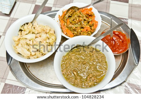 Different kinds of traditinal Ethiopian wot (stew) served in a bowl.