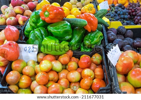 Different kinds of vegetables and fruits seen on a market - stock photo