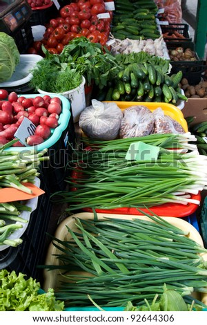 Different kinds of vegetables at an outdoor farmer market - stock photo