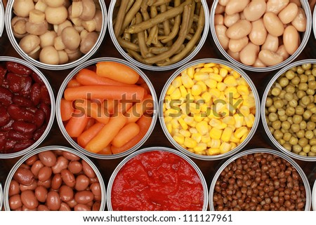 Different kinds of vegetables such as corn, peas and tomatoes in cans - stock photo