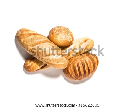 Different  kinds of  wheat bread  isolated on white - stock photo