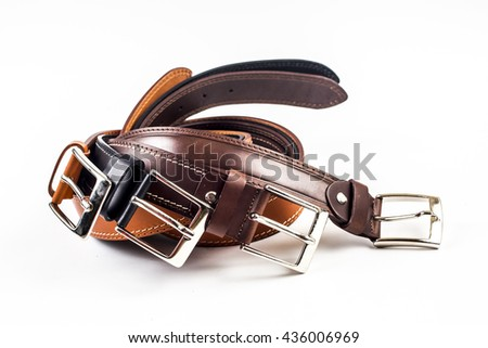 Different leather belts on white background - stock photo