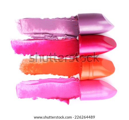 Different lipsticks isolated on white - stock photo