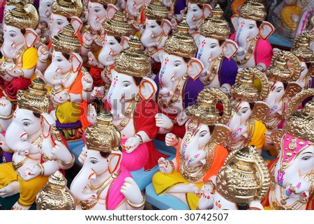 Different Lord Ganesh idols for sale in a shop on the ocassion of Ganesh festival in India. - stock photo