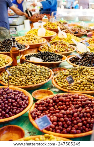 Different marinated olives on provencal street market in Provence, France. Selling and buying. Healthy local food market. - stock photo