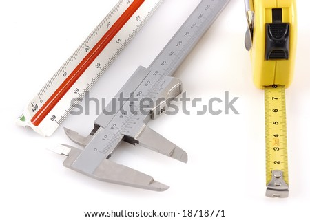 Different measuring apparatus on a white back ground - stock photo