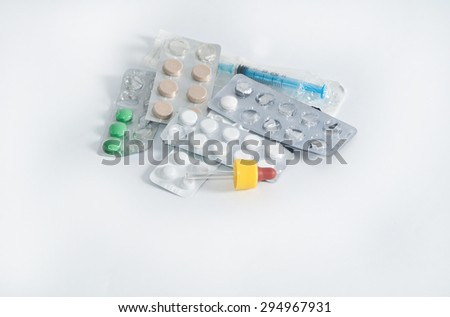 different medications in blister packs, syringe and  pipette isolated - stock photo