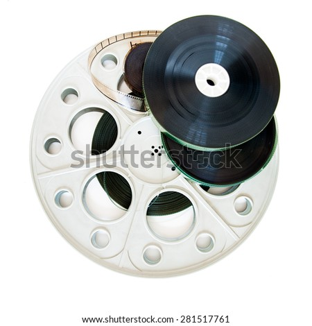 Different 35mm movie reels isolated on white background - stock photo