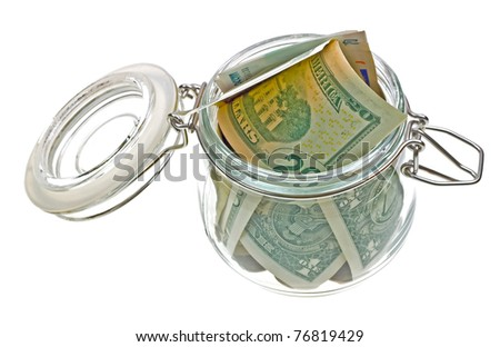 Different money in the glass jar isolated on white background