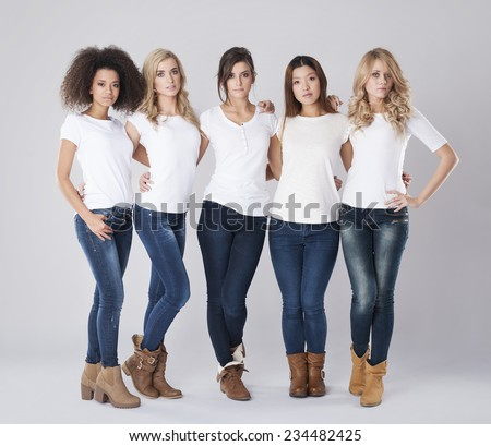 Different nationalities of young women - stock photo
