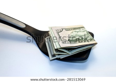 different notes of dollars on a kitchen shovel
