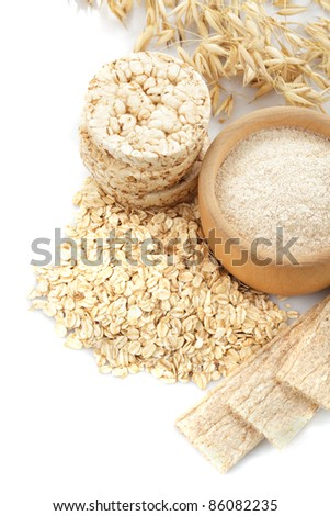 Different oat products isolated on white background - stock photo