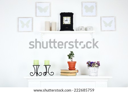 Different objects on white shelf in living room - stock photo