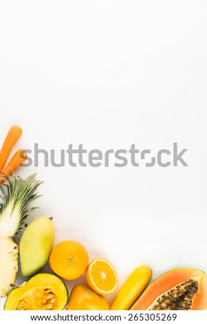 Different orange vegetables and fruits: food background - stock photo