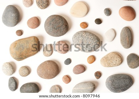 Different pebbles on white (with a shadows) - stock photo