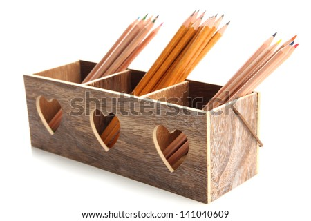 Different pencils in wooden crate, isolated on white