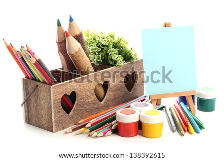 Different pencils in wooden crate, paints and easel, isolated on white - stock photo