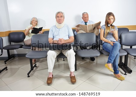 Different people sitting in a waiting room of a hospital - stock photo