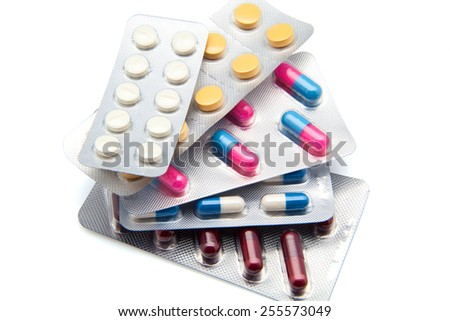 different pills isolated on white