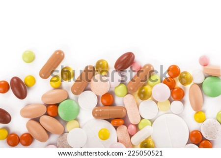 different pills isolated on white background - stock photo