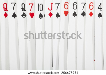 Different playing cards on white background - stock photo