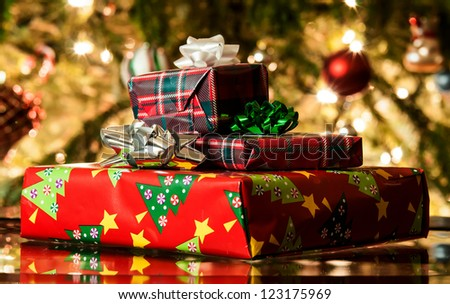 different present boxes under Christmas tree in holiday eve, Christmastime celebration, home decorated with festive shiny balls, magic x-mas night - stock photo