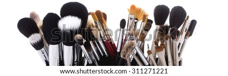 Different professional natural soft make-up brushes for eyeshadow powder and facial foundation for visagistes black and brown colors on white background, horizontal picture - stock photo