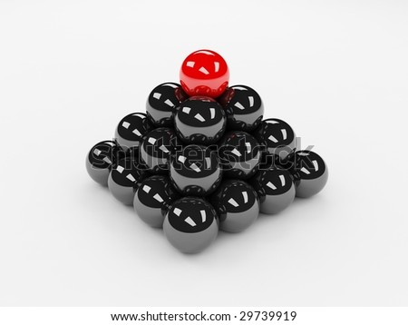 Different red ball on top of the black ones - stock photo
