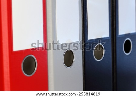 different ring binders in row, close up shot - stock photo