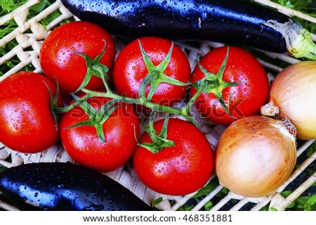 different ripe vegetables on wicker plates  the grass. healthy foods